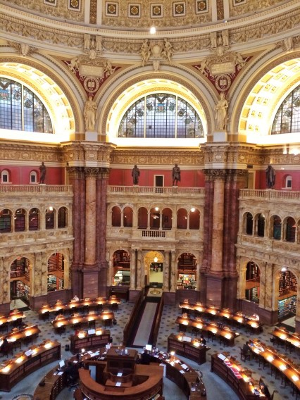 Shot through the glass of the viewing gallery. Below is the Main Reading Room, where researchers can order and read books from the Library's massive collection. The books cannot be taken out of the Library, but anyone 18 and above who is conducting academic research may apply for a library card to use the collections.