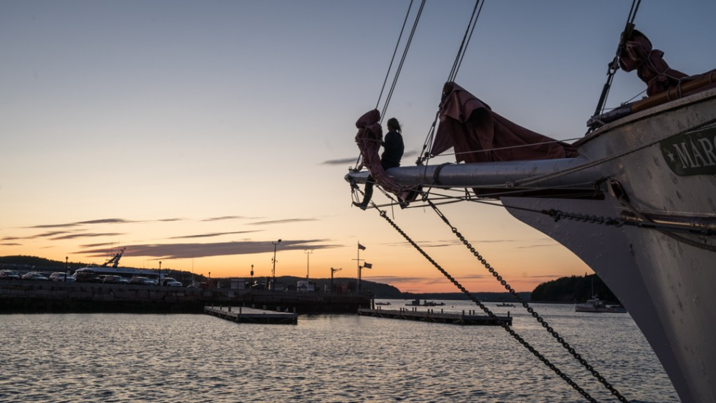 Crew readies the sails for the night aboard the Margaret Todd historic sailboat
