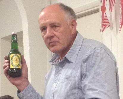 A solemn moment - the last bottle of the 2015 vintage cider is raffled at the 2016 Harvest Supper. Photo: Kim Elliott