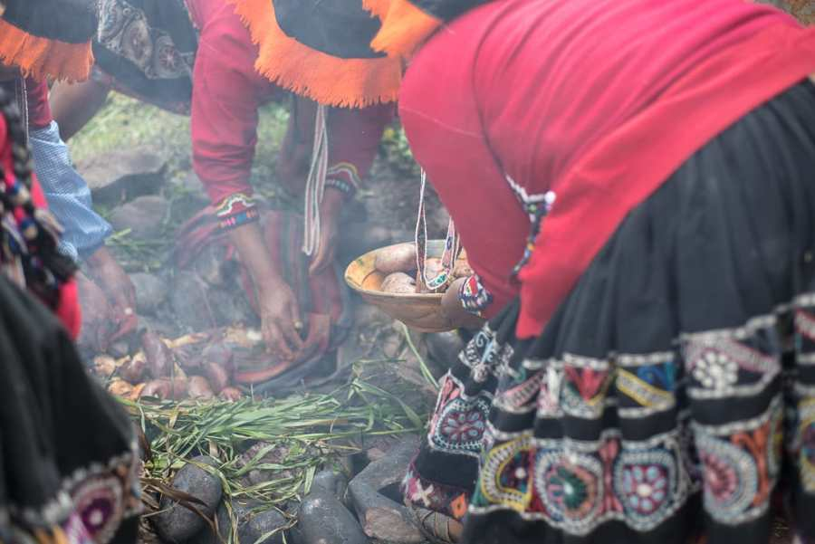 Things to do in Sacred Valley - Pachamanca preparation.