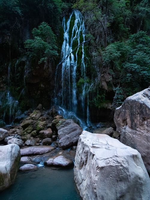 Water runs down a waterfall in to the pools below, Bolivia