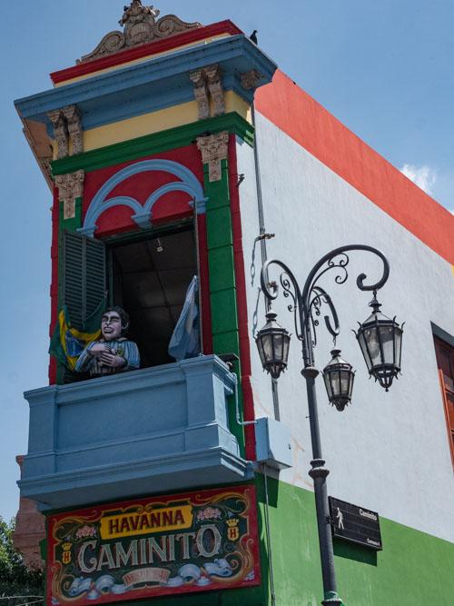A Diego Maradona above a colourful bar on El Caminito, Buenos Aires, Argentina