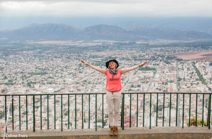 A lady stands at a mirador for a skyline view of Salta, Argentina