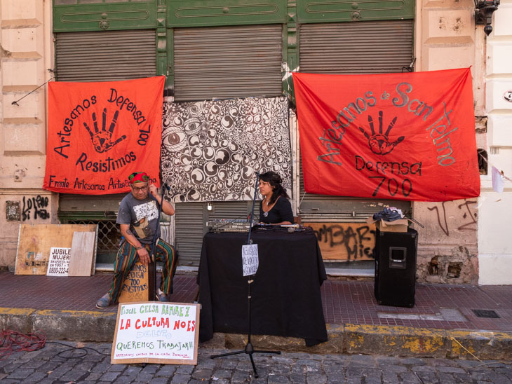 A man and woman perform on a San Telmo street at the Sunday market, Buenos Aires, Argentina