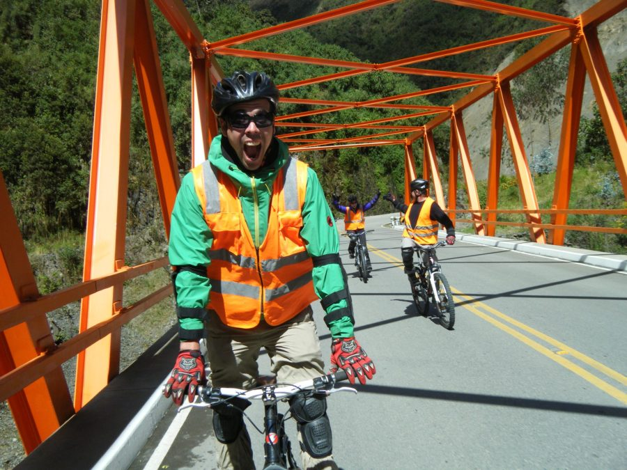 Inca Jungle Trail - Excited cyclist crosses a bridge.