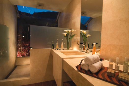 Suites come with exquisite marble bathrooms.