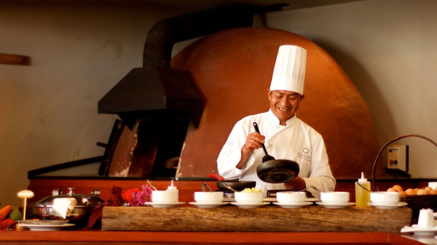 Luxury hotels in Sacred Valley - Chef preparing food at Aranwa Sacred Valley hotel.