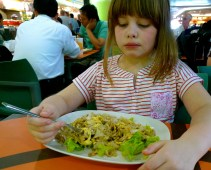 From the MBK food court: wide fried noodles with egg and chicken. Despite her expression, she really liked it.