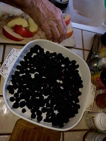 Preparing berry apple crumble