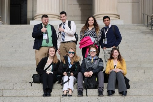 franklin-pierce-university-students-sitting-outside-the-national-archives-surrounding-the-national-mall-in-washington-d-c