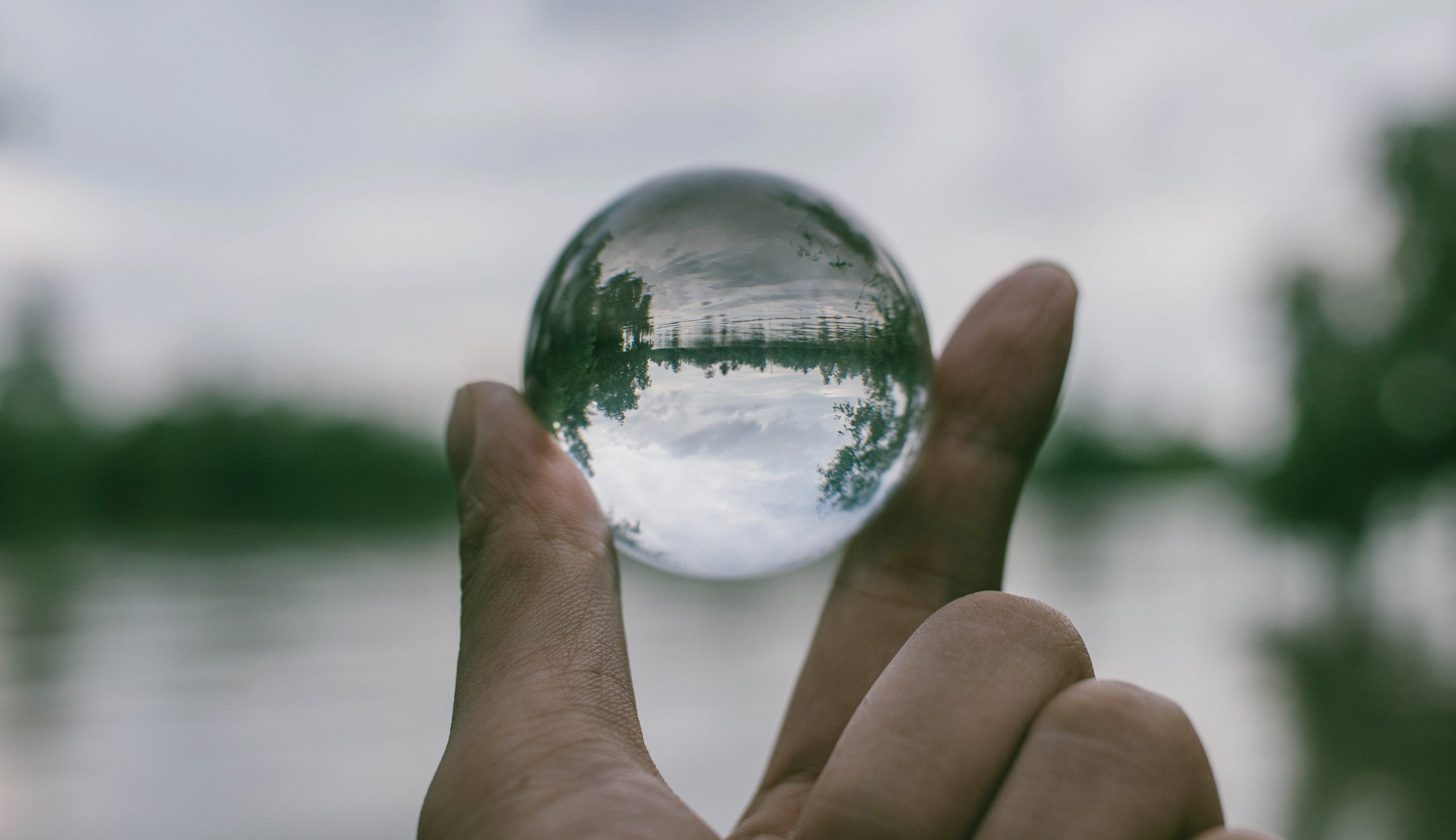 close-up-photography-of-person-holding-crystal-ball-1071249