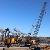 Cranes being prepared next to river