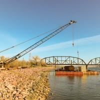 Crane moving materials onto barge_4.29.21