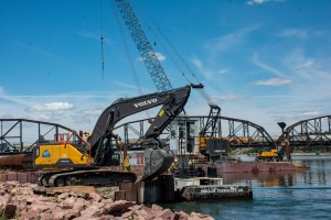 Backhoe used for cleaning the sludge off the barge_6.29.21