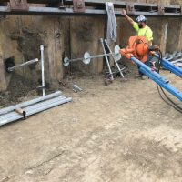 Screwing in tie backs along temporary shoring_9.11.21