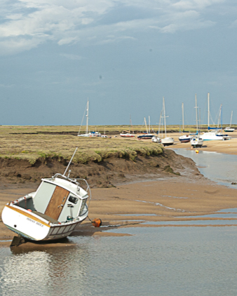 Boat on sandbank at Moreston, North Norfolk
