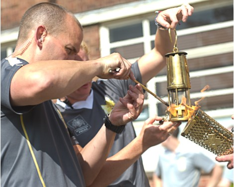 The Olympic Flame Flame being transferred to a miner's lamp