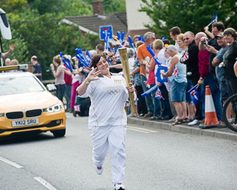 Jodie Andrews participating in Olympic Torch relay in Cromer, North Norfolk