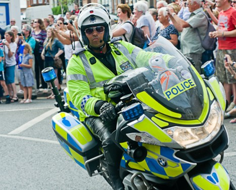Police motorcyclist escorting the Olympic Torch relay in Cromer, North Norfolk