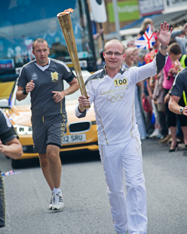 Harry Heathfield carring the Torch in the Olympic Torch relay in Cromer, North Norfolk