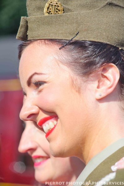 Girl in American uniform smiling at the 1940s weekend at Sheringham 2012