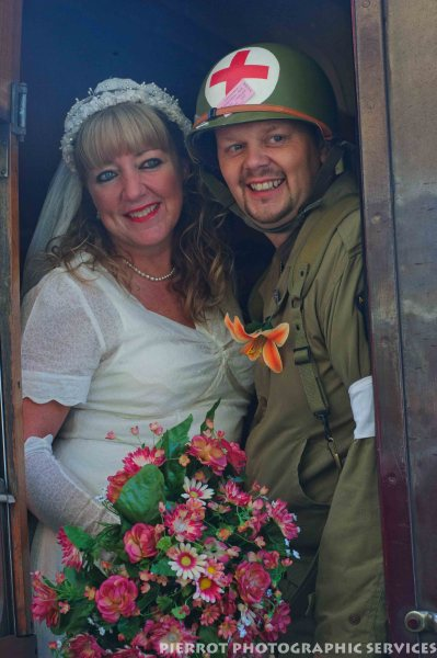 American bride and soldier in railway carriage at the 1940s weekend in Sheringham 2102
