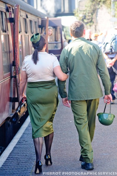 American military couple walking hand in hand at the 1940s weekend in Sheringham, North Norfolk 2012