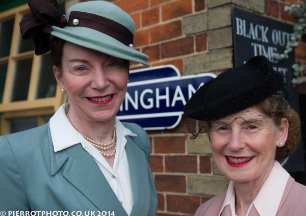 1940s weekend in Sheringham North Norfolk 2014 - two attractive women wearing hats