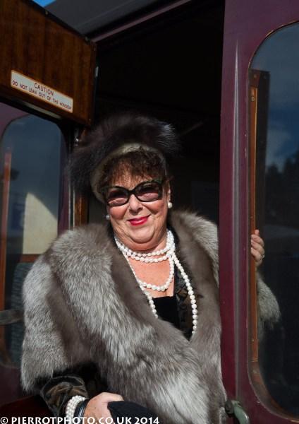 1940s weekend in Sheringham North Norfolk 2014 - woman in hat with huge fur coat