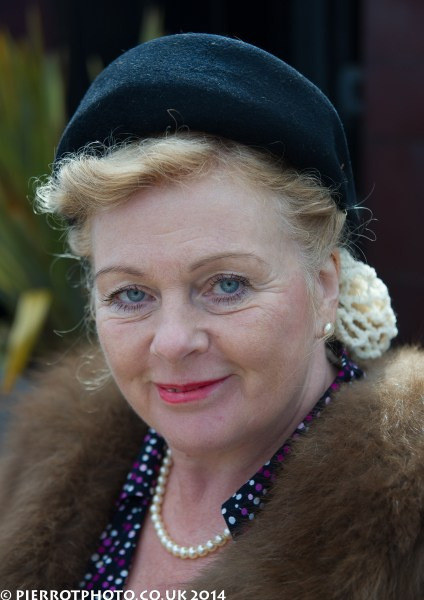 1940s weekend in Sheringham North Norfolk 2014 - woman in fur coat, blue hat and pearls
