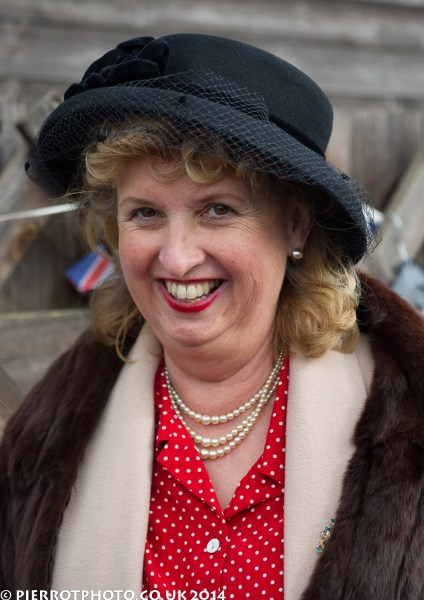 1940s weekend in Sheringham North Norfolk 2014 - smiling woman with hat