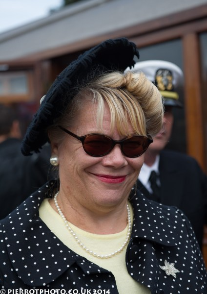 1940s weekend in Sheringham North Norfolk 2014 - woman in polka dot jacket and blue hat