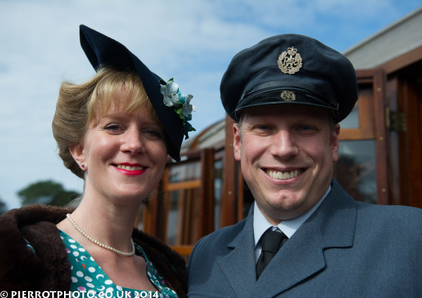 1940s weekend in Sheringham North Norfolk 2014 - attractive women with hat and RAF officer