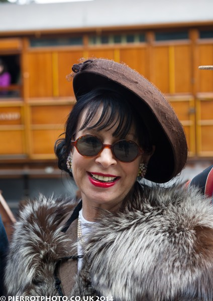 1940s weekend in Sheringham North Norfolk 2014 - lady in brown hat and fur stole