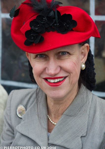 1940s weekend in Sheringham North Norfolk 2014 - woman in bright red hat