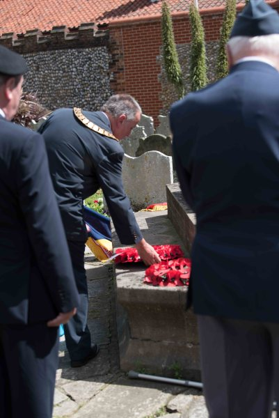 Cromer mayor John Frosdick laying a wreath at the war memorial in Cromer during the Passchendaele service.