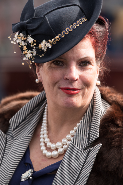 1940s weekend in Sheringham North Norfolk 2017.. Woman with pearls and black hat with flowers.