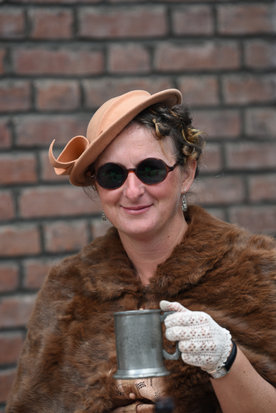 1940s weekend in Sheringham North Norfolk 2017. Lady in fur stole holding pewter tankard