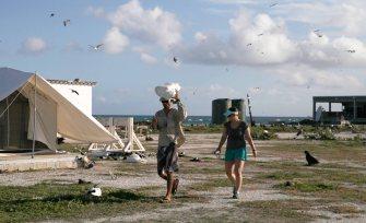 Mark retrieving tent fly, accompanied by Megan
