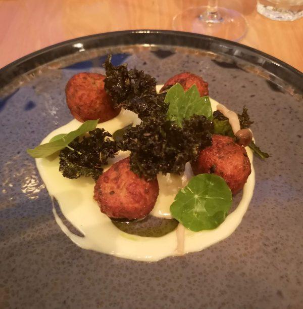 Potato and parsley dumplings, taleggio, crispy kale