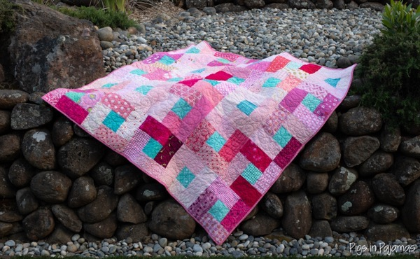 Grace circle quilt draped over stones