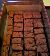 fudge brownies with salted peanuts and alcoholic sour cherries