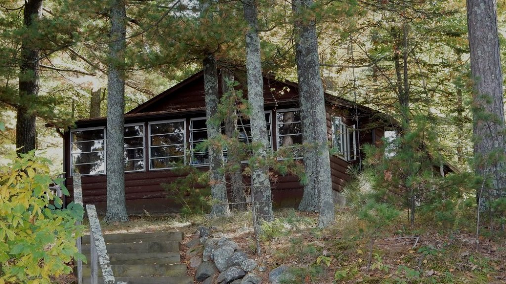 Cabin in the woods. Photo © Kathie Scrimgeour