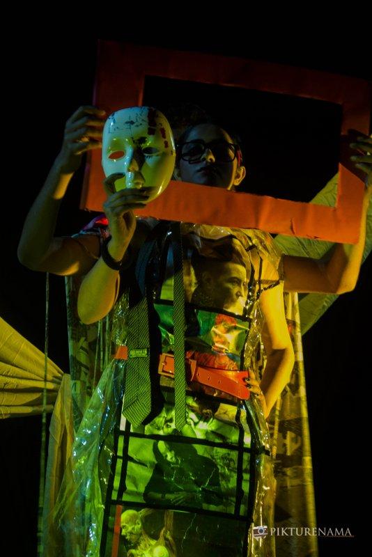 Ishita looks at her mask as a part of Fine Art photography workshop kolkata by Agnimirh Basu