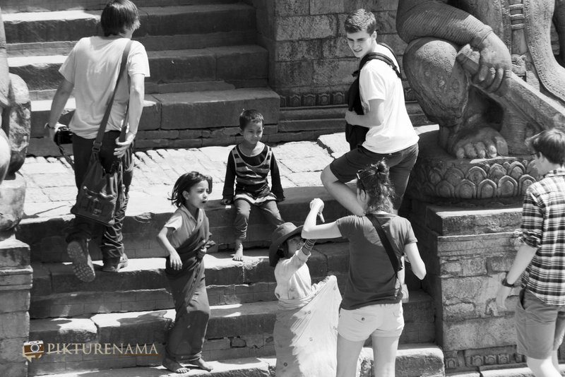 Kids with tourists at Bhaktapur Durbaraquare Nepal