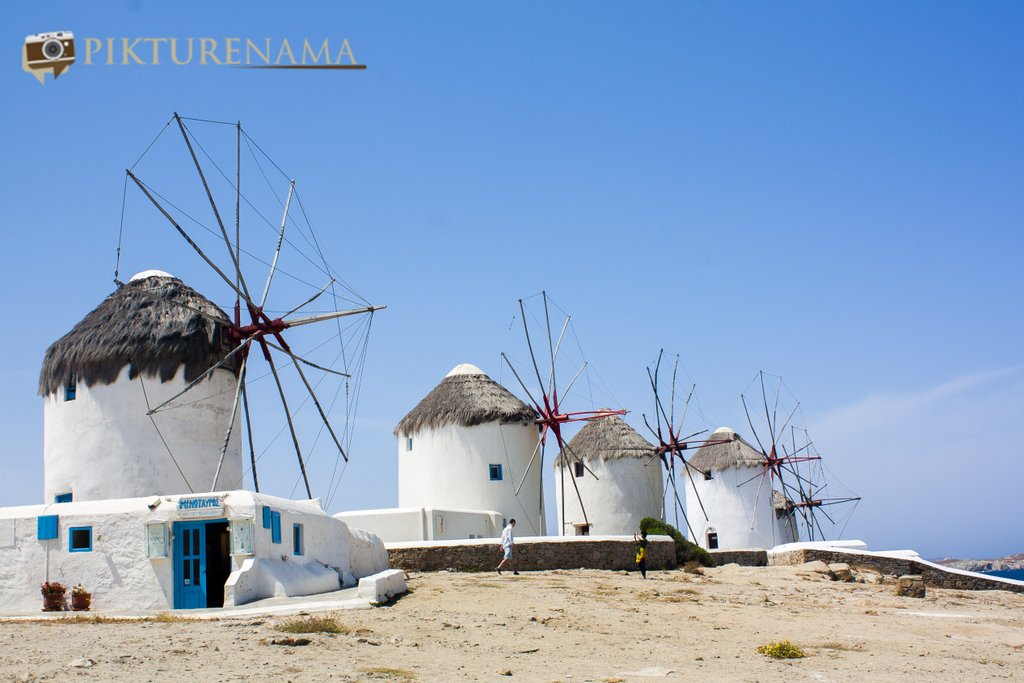 Kato Myloi - The windmills of Mykonos Greece by pikturenama onlooking into the sea