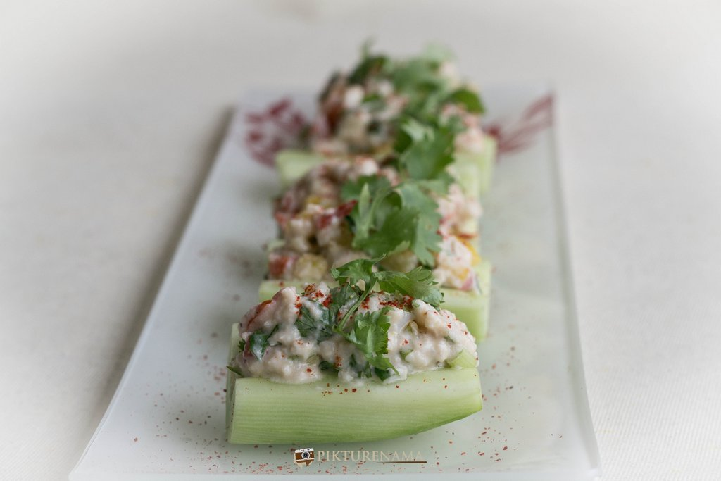 Cold crab salad in cucumber boats once ready