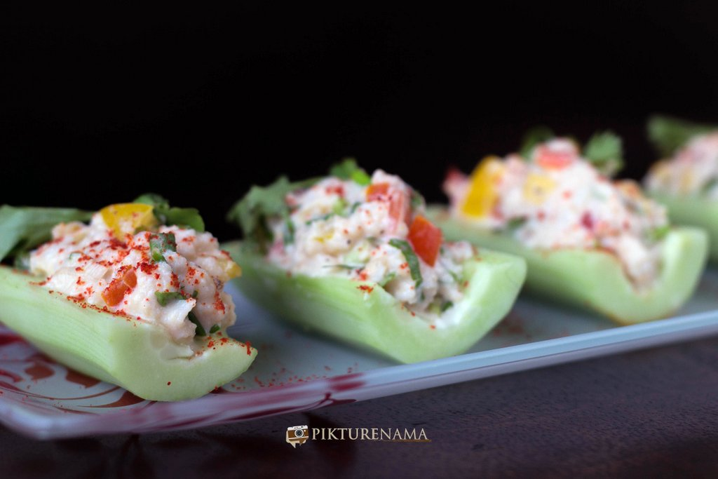 Cold crab salad in cucumber boats once ready by pikturenama