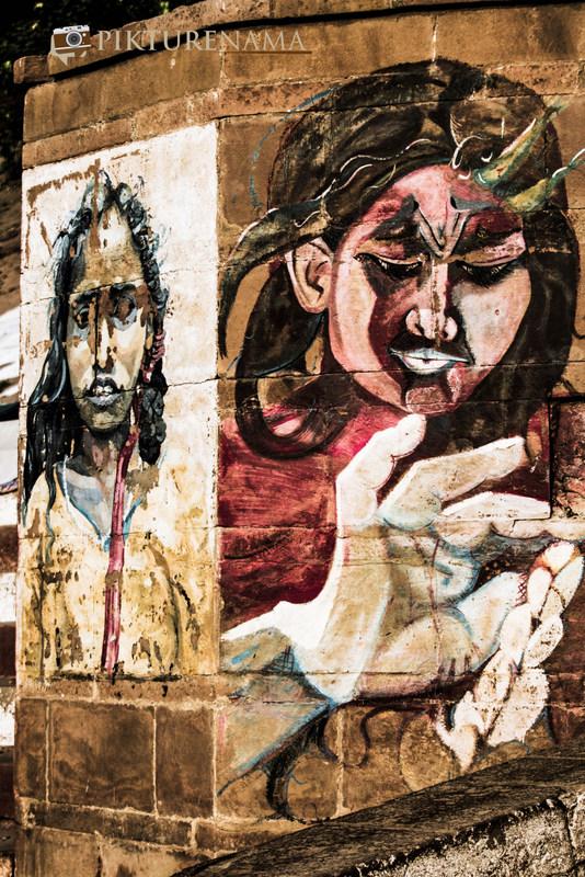 Graffiti on Varanasi Ghats faces on the wall