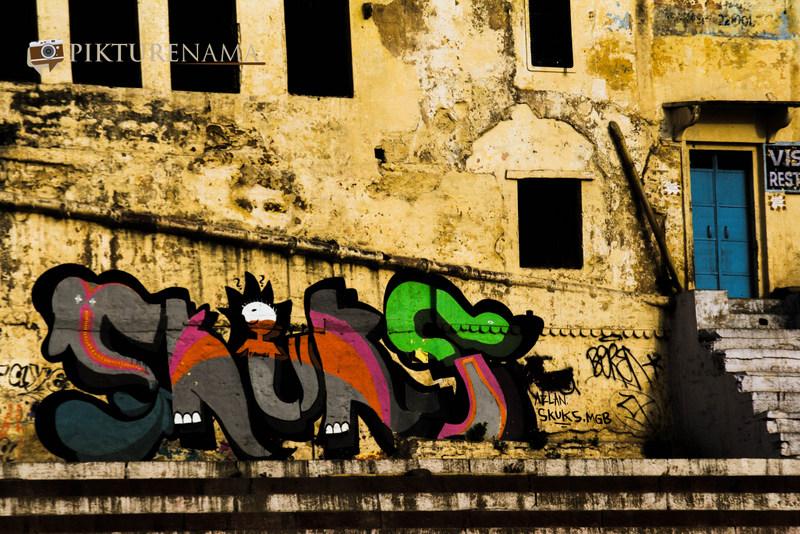 Graffiti on Varanasi Ghats with blue door